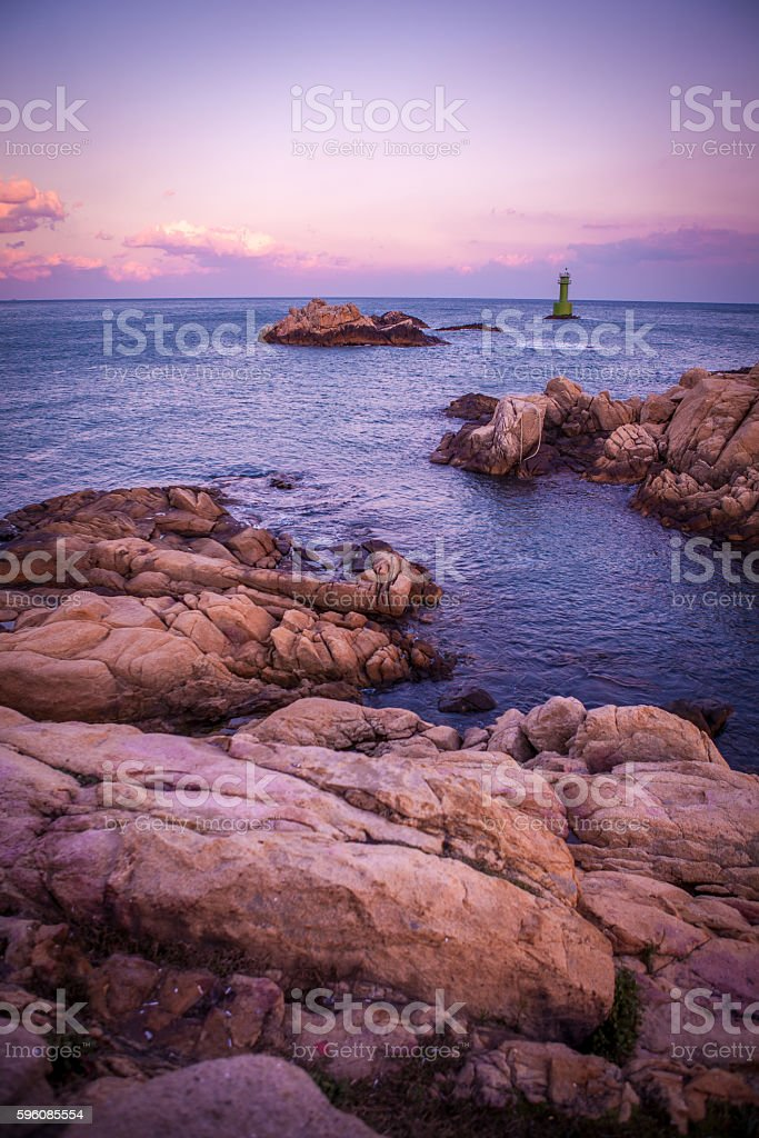 Light house in sunset sea royalty-free stock photo