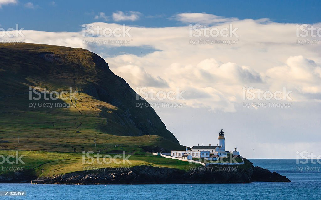 Light house on an island, Scotland stock photo