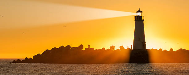 Light house with sunset in the background Light house, Santa Cruz, California, USA beacon stock pictures, royalty-free photos & images