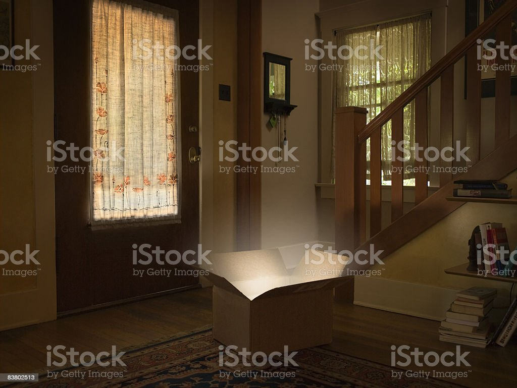 Light illuminating from box sitting on floor  royalty-free stock photo