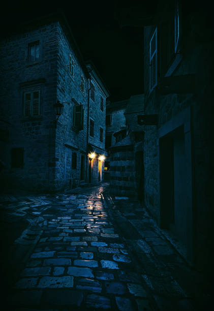 Light in a Dark Alley, Kotor, Montenegro Kotor is a coastal town in Montenegro alley stock pictures, royalty-free photos & images