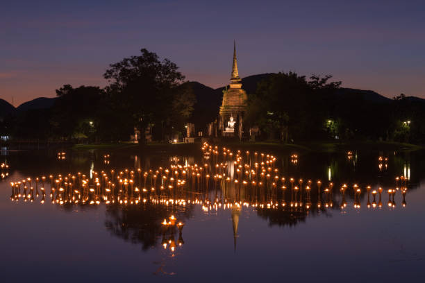 light in buddha statue in loy kratong festival, sukhothai histor - kratong stock photos and pictures