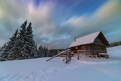 light in cozy hut in winter