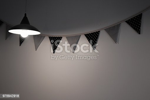 840777964istockphoto Light in dark room 975942918