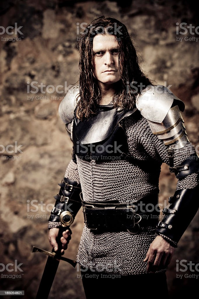 Light in his chain mesh holding a sword stock photo
