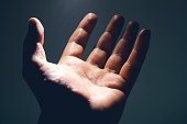 istock Light in human hand in the dark, miracle concept 1153652560
