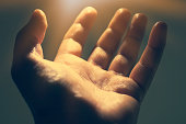 istock Light in human hand in the dark, miracle concept 1153652586