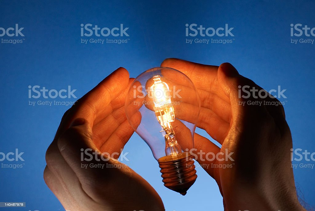 Light in my hands stock photo