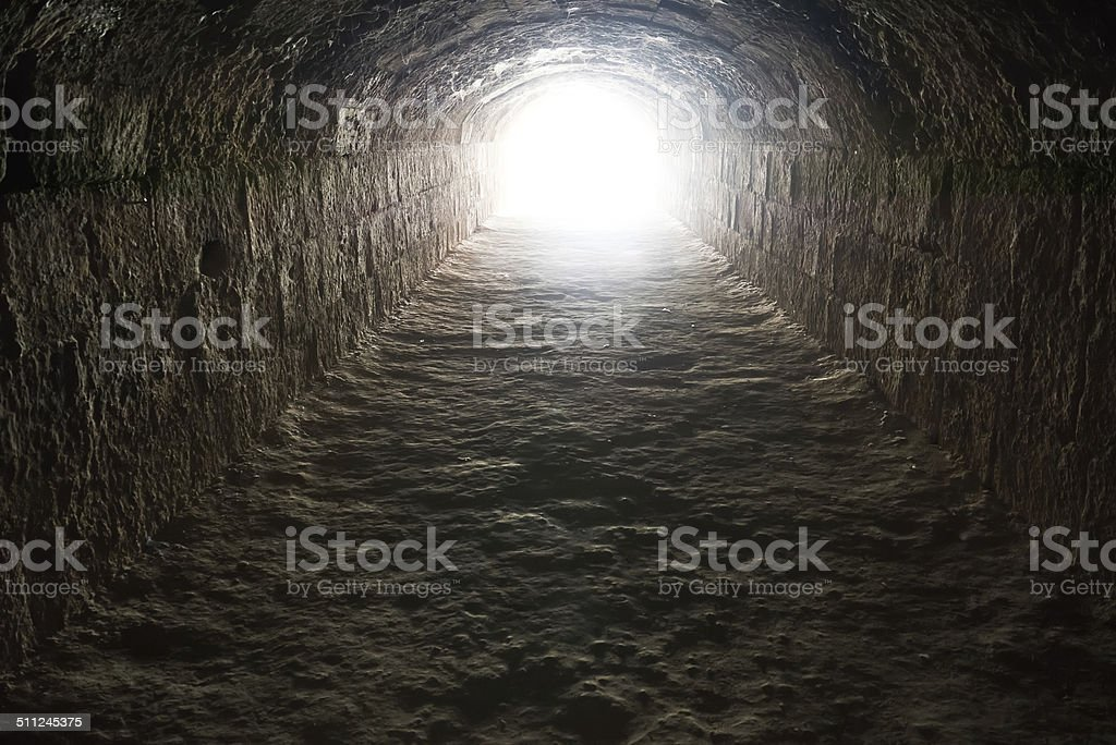 Light in the end of the tunnel stock photo