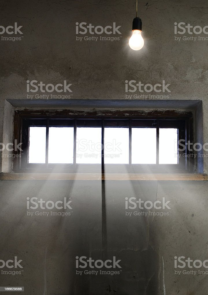 Light is coming through the barred window royalty-free stock photo