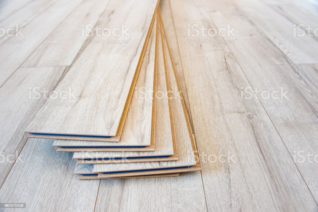 Light laminate on the floor with some laminate left after work stock photo
