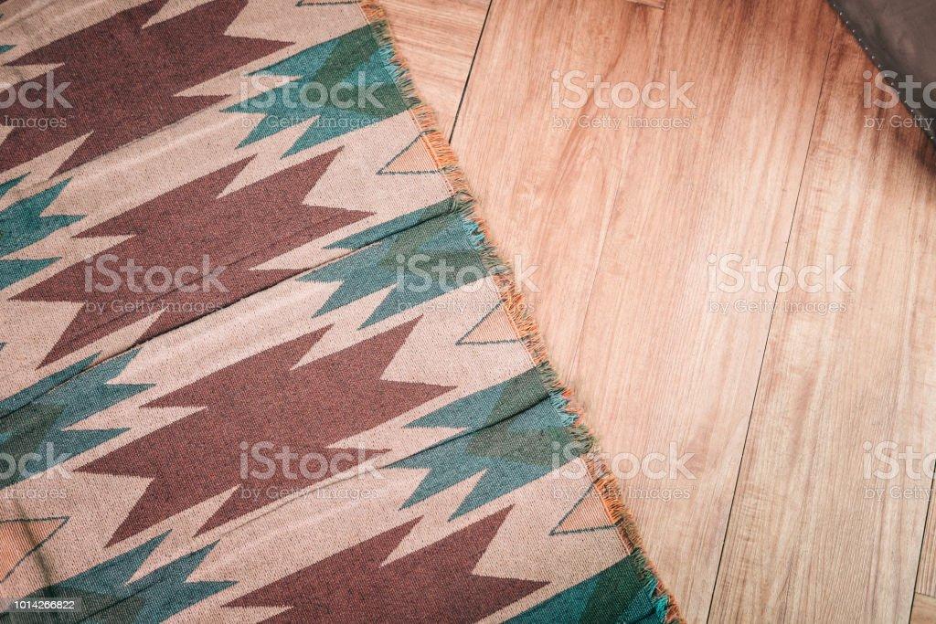 Light laminate parquete floor with carpet stock photo