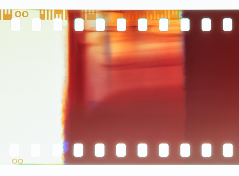 Close-up of 35mm negative photographic film, showing an abstract pattern caused by a light leak.