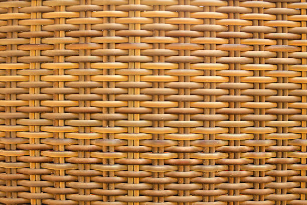 Light natural wicker textured material Light natural wicker textured material wicker stock pictures, royalty-free photos & images