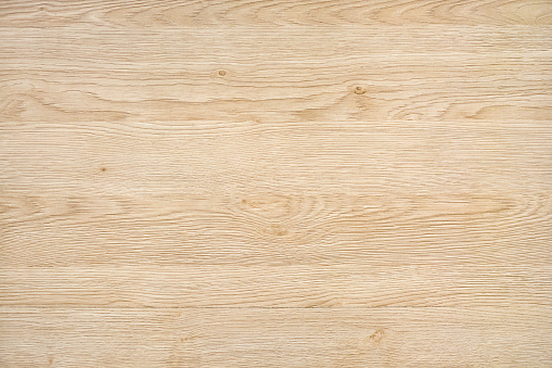 Light natural wood board composed of six logs. All boards have a strong clear texture of wood and some contain knots. The plank is new and clean. A wood grain pattern featuring even grains of wood running horizontally across the image.
