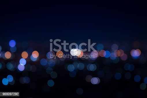 Light night at city blue bokeh abstract background texture blur lens flare reflection beautiful circle glitter merry christmas and happy new year card celebration lamp  dark sky.