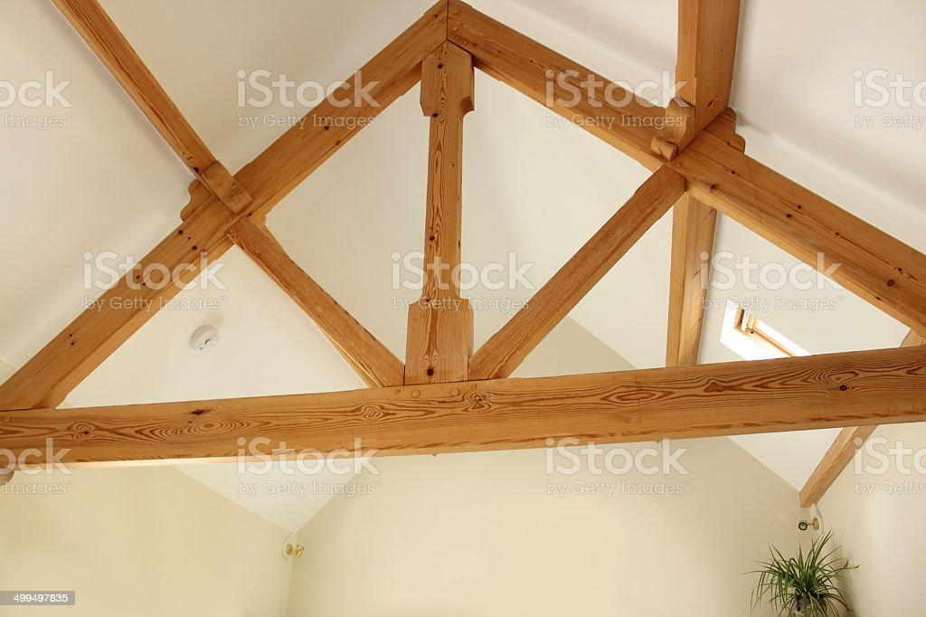 Light oak ceiling beams in modern open-plan house, kitchen room stock photo
