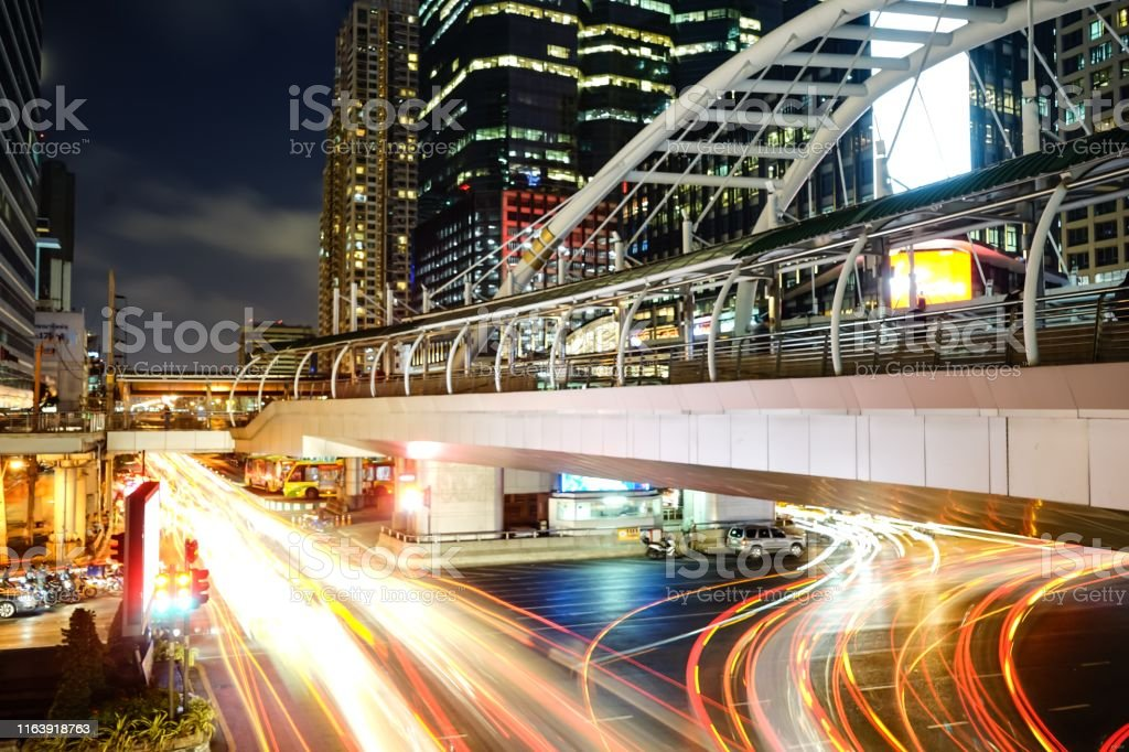 Slow shutter photos of car lights on the road, including bridges and...