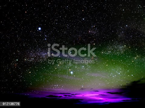 istock light of colorful cloud in night sky stars on universe 912138776