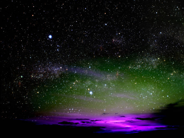 light of colorful cloud in night sky stars on universe stock photo