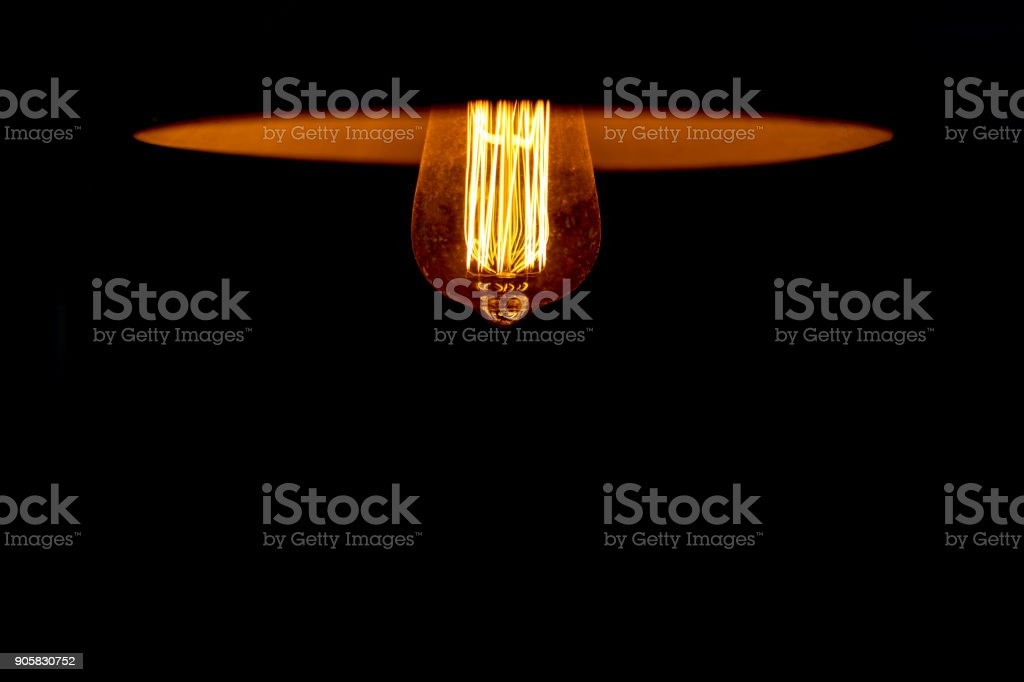 Light of vintage lamp with black background. copy space stock photo