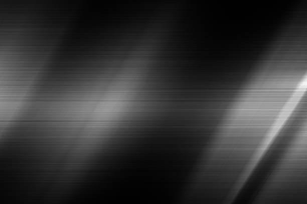 luz na textura de aço preto - cromo metal - fotografias e filmes do acervo