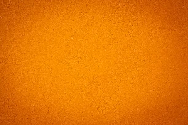 light orange color wall texture - vaste stof stockfoto's en -beelden