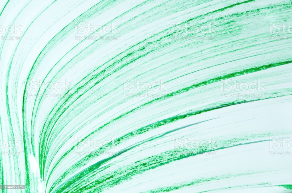 A green and white curved painted surface