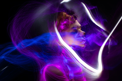 new art direction, long exposure photo without processing, light drawing at long exposure