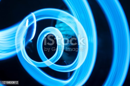 Man hiding her face with hand. Light paiting blue concept. Technology visual.