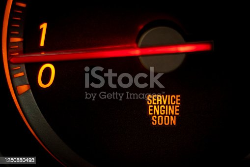 """SERVICE ENGINE SOON"" light on dashboard of car in need of service or repair"
