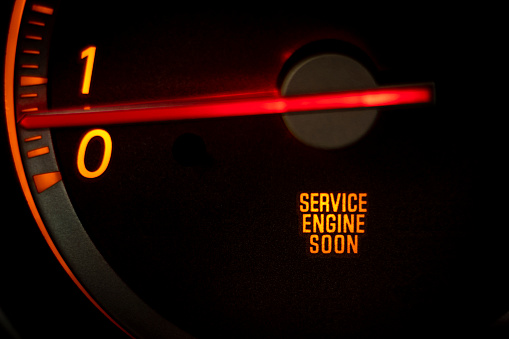"""""""SERVICE ENGINE SOON"""" light on dashboard of car in need of service or repair"""