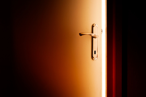 Door opens and lets the  orange light in. Useful for multiple concepts, business opportunity, taking chances, hope,