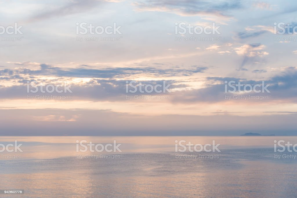 Light Pink and Blue Sunset on Mirror Sea stock photo