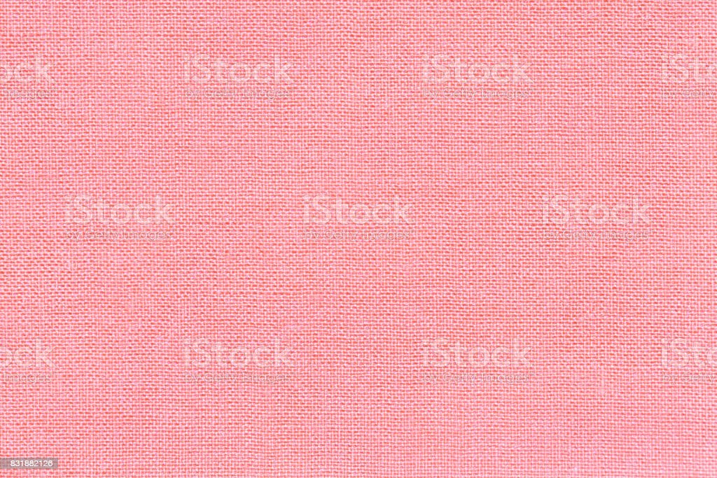 Light pink background from a textile material with wicker pattern, closeup. stock photo