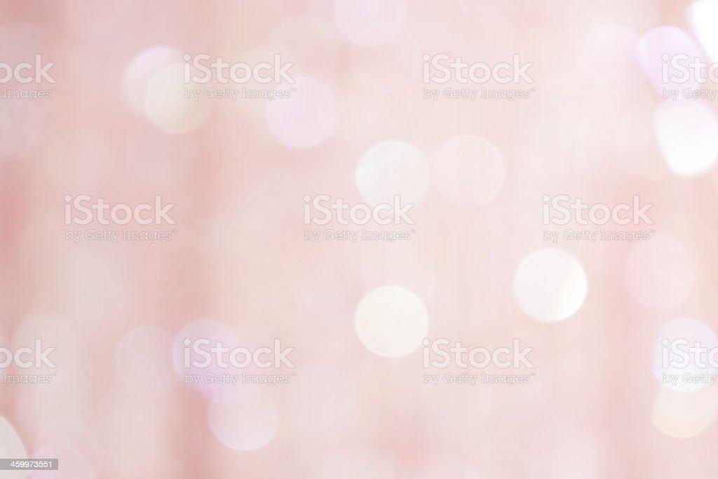 Light pink defocused sequin fabric background.