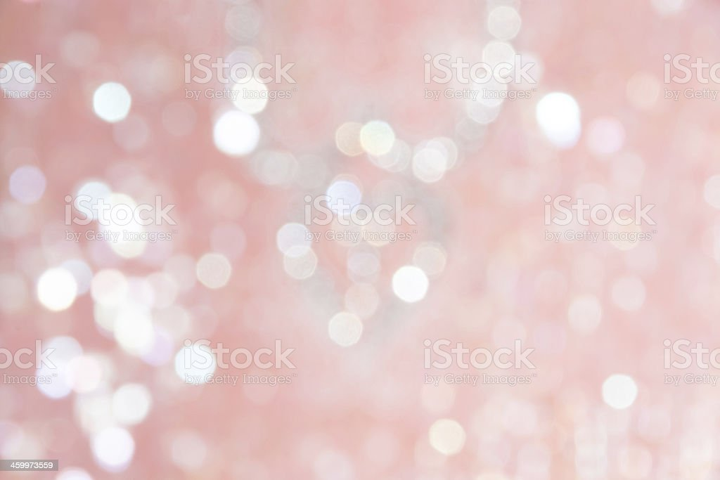 Light pink fabric with slightly defocused sequins. stock photo