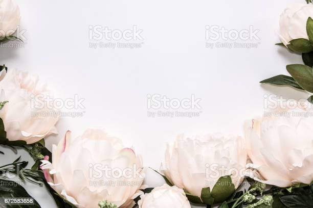 Light pink faux peony flowers around white background with copy space picture id672583658?b=1&k=6&m=672583658&s=612x612&h=tmv6efs6eyubxoowm0fmhuhfjskwnzzctlymxikg4jq=