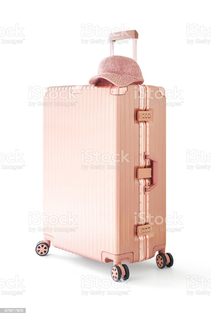 Light pink gold suitcase or luggage and cap on top isolated on white background . stock photo