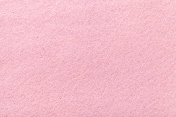 Light pink matt suede fabric closeup. Velvet texture of felt. Light pink matte background of suede fabric, closeup. Velvet texture of seamless rose woolen felt. felt textile stock pictures, royalty-free photos & images