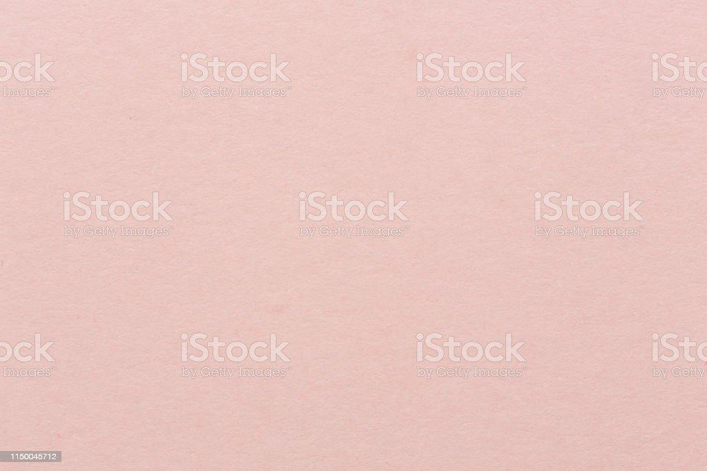 Light pink textured decoration paper. Bright pink background. High...