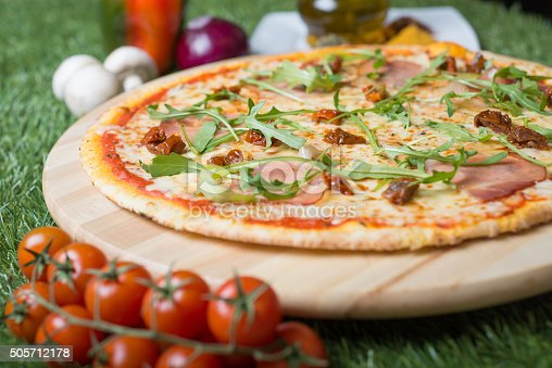 Traditional italian pizza at very cripsy and thin pastry,