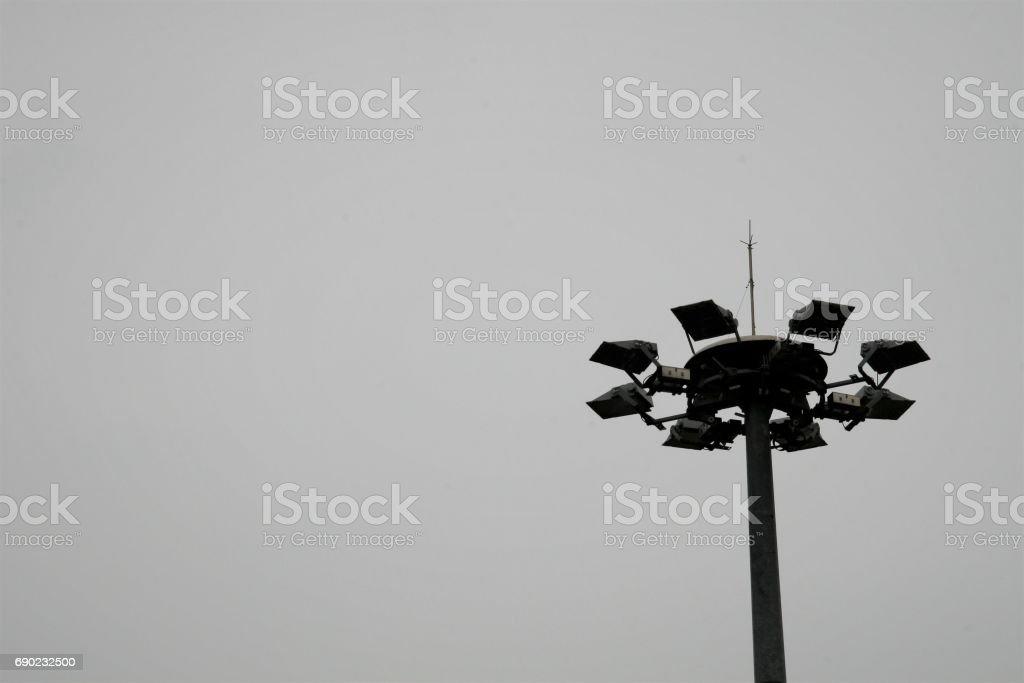 Light pole on the sky background