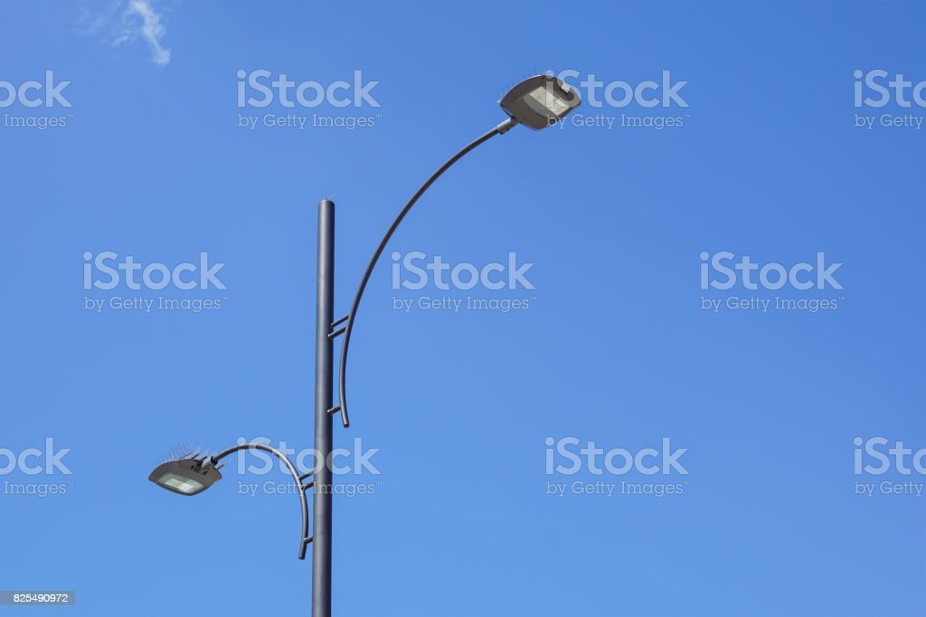Light Pole Tower On Blue Sky Stock Photo - Download Image