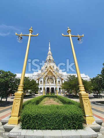 Light poles and the Luang Phor Sothon Temple in Thailand