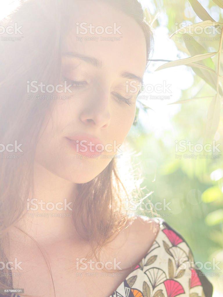 Light portrait of an beautiful lady stock photo