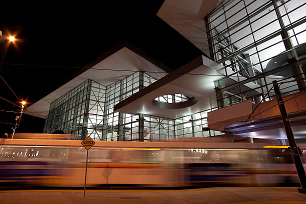 Light rail train and convention center downtown Denver Colorado stock photo