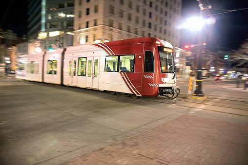 Motion blur shot of light rail train in Salt Lake City at night time.