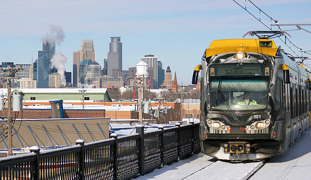 Light rail train with skyline of Minneapolis stock photo