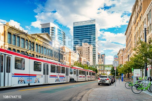 Light rail tram moves in downtown Salt Lake City Utah USA on a sunny day.